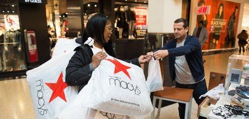 Karen Smith of Brooklyn lugs around bags filled