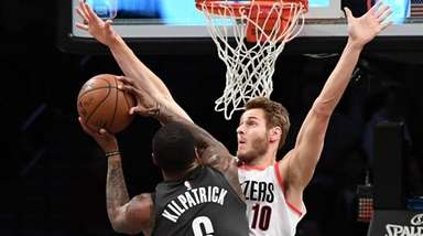 Brooklyn Nets guard Sean Kilpatrick goes up against