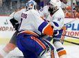 New York Islanders' Nick Leddy, right, drives Philadelphia