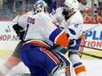 New York Islanders' Nick Leddy, right, drives Philadelphia