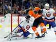 New York Islanders goalie Thomas Greiss, left, blocks
