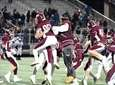 Garden City players celebrate after beating North Babylon,