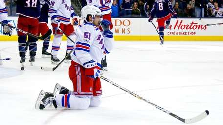 David Desharnaisof theRangers reacts to his team giving