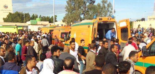 People gather around ambulances following a gun and