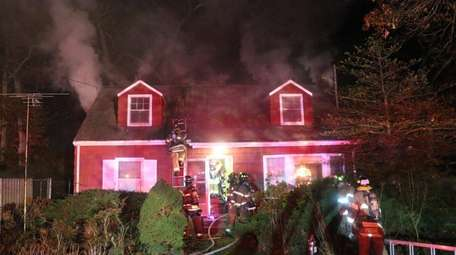 Firefighters respond to a blaze in Lake Grove