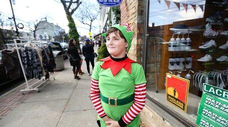 The parade's head elf, Zacharia Ferris, 11, of