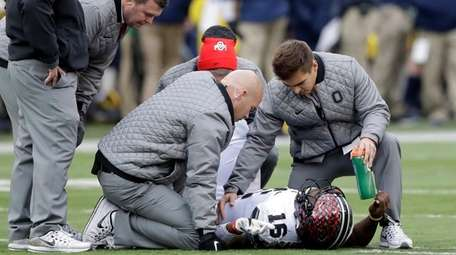 Ohio State quarterback J.T. Barrett is looked at