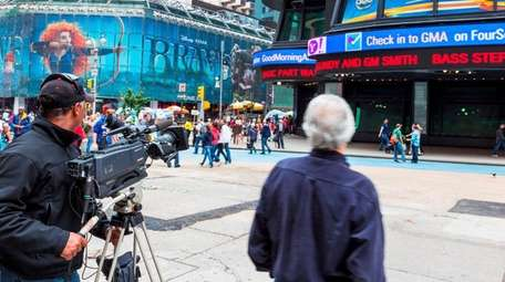 A film crew works in Times Square in
