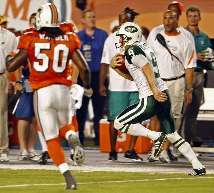 New York Jets' punter Steve Weatherford runs for