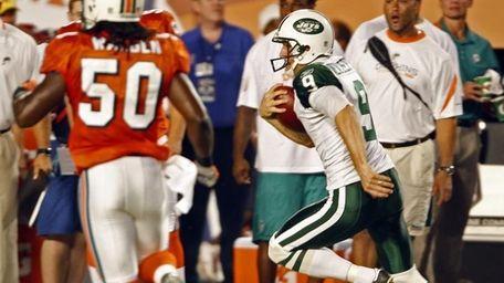 New York Jets' punter Steve Weatherford runs for