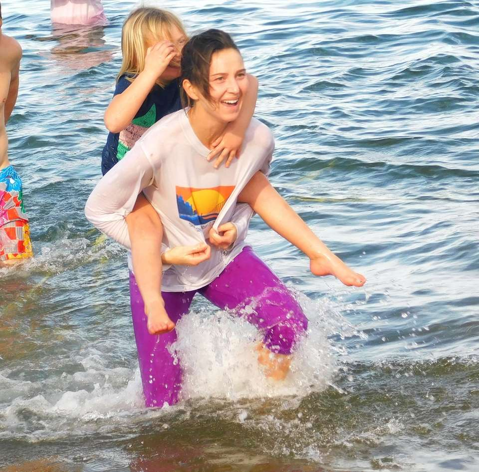 Dozens of participants dashed into the waters during