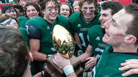 Westhampton's Dylan Laube, right, and teammates hold up