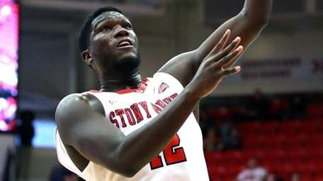 Stony Brook forward Tyrell Sturdivant sinks a layup during