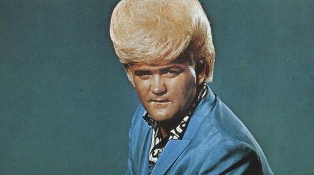 Flamboyant soul singer Wayne Cochran poses for a
