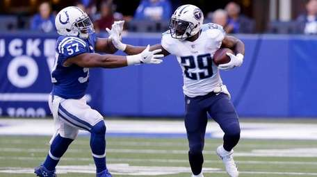 The Titans' DeMarco Murray runs against the Colts'