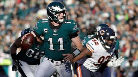 The Eagles' Carson Wentz looks to pass against