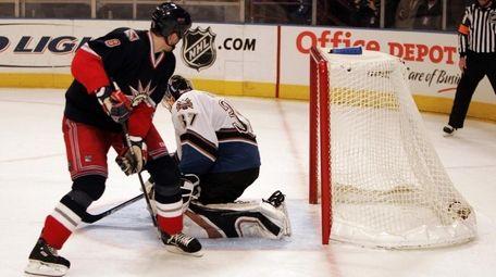 The Rangers' Marek Malik scores a shootout goal