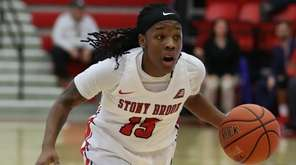 Stony Brook guard Shania Johnson drives up court