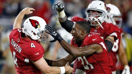 Cardinals kicker Phil Dawson celebrates his game winning