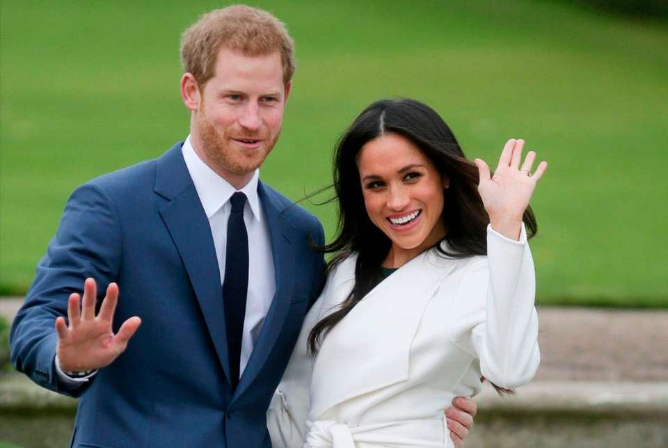Prince Harry and his fiancee Meghan Markle pose