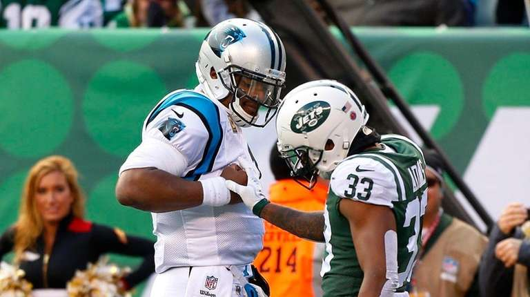 Cam Newton #1 of the Carolina Panthers confronts