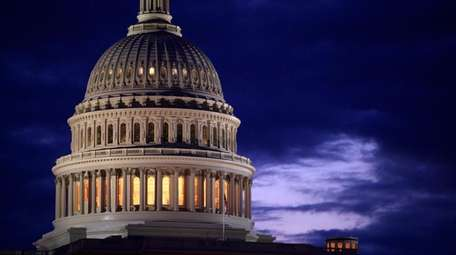 The U.S. Capitol domeat dawn in Washington.