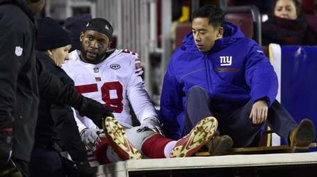 Curtis Grant of the Giants is carted off