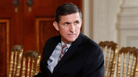 Then-National Security Adviser Michael Flynn sits in the