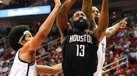 Rockets guard James Harden drives to the basket