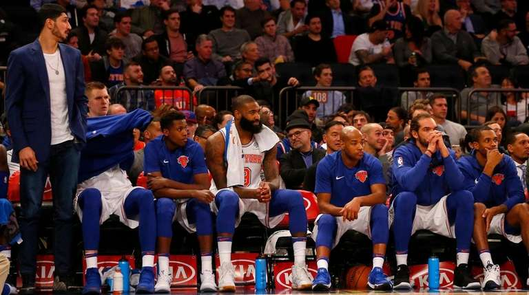 The Knicks' bench looks on during the second