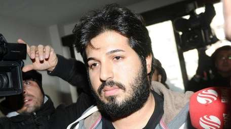 Reza Zarrab arrives at a police center in