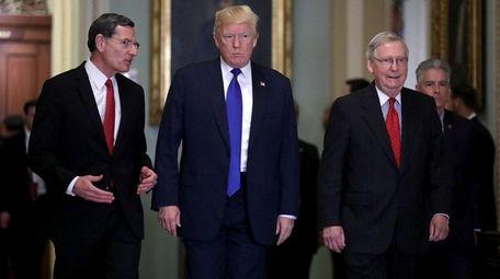 Sen. John Barrasso, left, President Trump and Senate