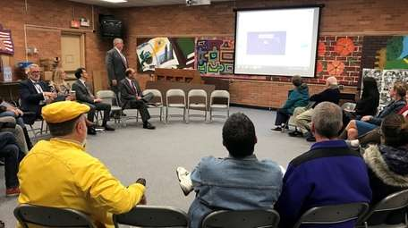 Port Jefferson residents and school district officials watch