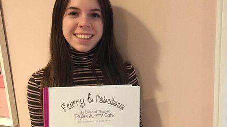 Port Washington teen Taylor Sinett holds her latest