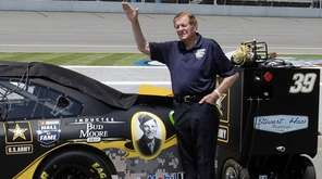 NASCAR Hall of Famer Bud Moore stands next