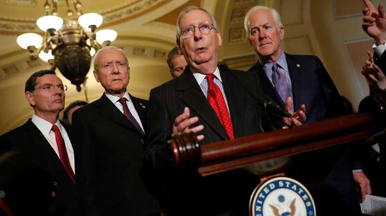 Senate Majority Leader Mitch McConnell, (R-Ky.), center, speaks