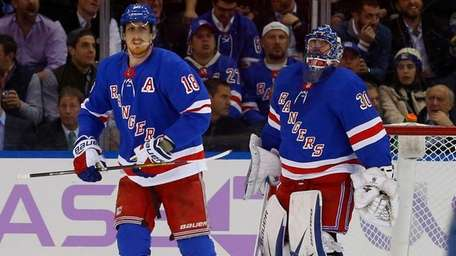The Rangers' Henrik Lundqvist and Marc Staal  look