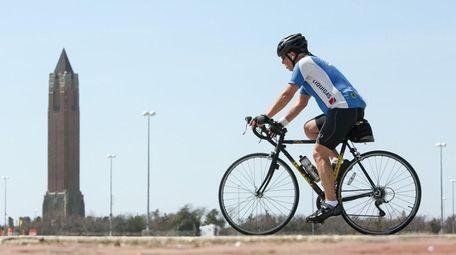 A man rides his bike on Tuesday, April
