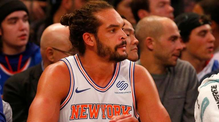 Joakim Noah watches from the Knicks' bench during