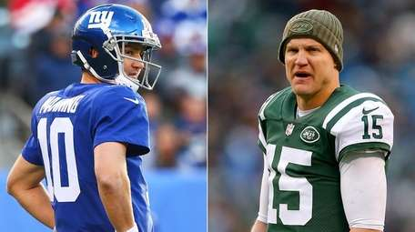 Eli Manning, left, is out as the Giants'