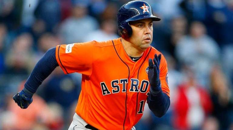 Carlos Beltran of the Astros doubles against the Yankees