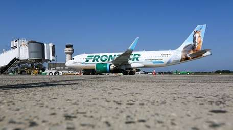 The first Frontier Airlines flight from Orlando, Fla.,