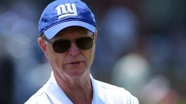 Giants co-owner John Mara on the field during