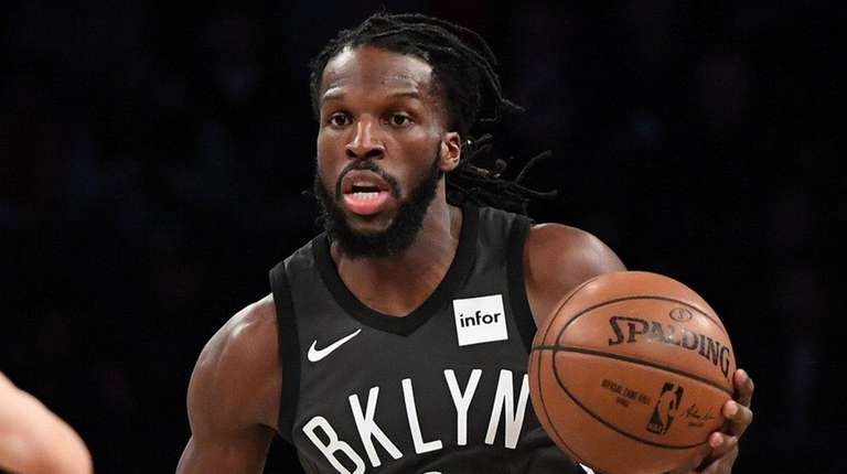 Nets forward DeMarre Carroll controls the ball against