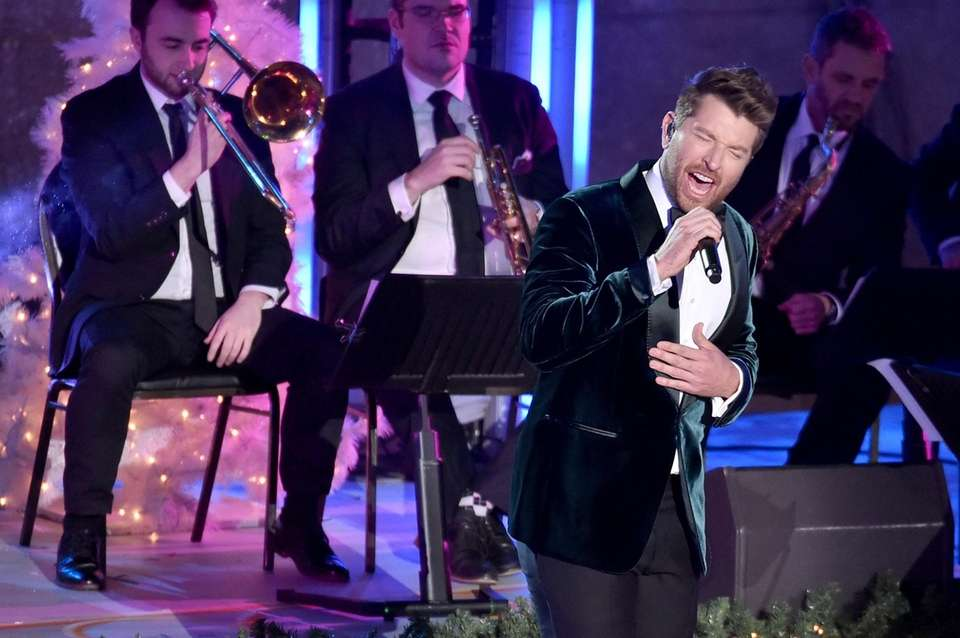 Brett Eldredge performs at the tree lighting ceremony
