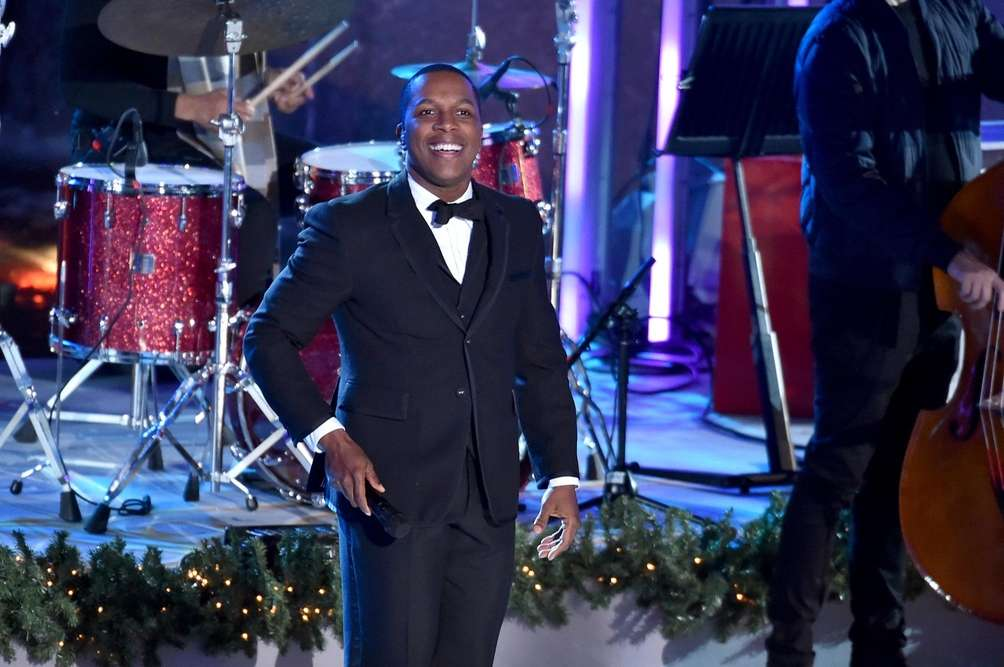 Leslie Odom Jr. performs during the tree lighting
