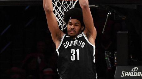 Nets center Jarrett Allen dunks against the Warriors