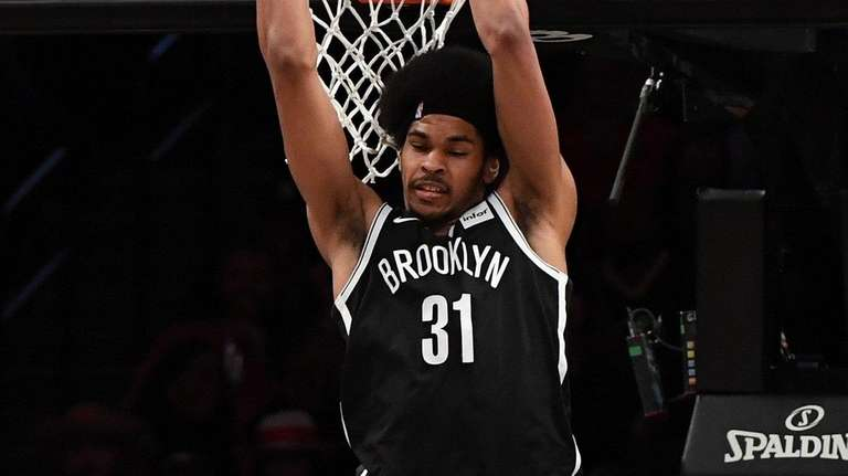 Nets center Jarrett Allen dunks against the Warriors