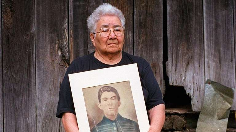 Beulah Timothy with a picture of her paternal