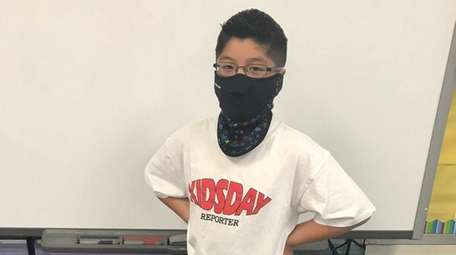 Kidsday reporter Laik Senh models the windproof Combo